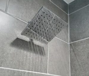 delta rain shower head adjustment