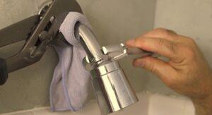 remove stuck shower head