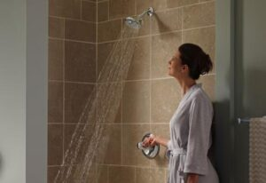 how to remove shower head flow restrictor